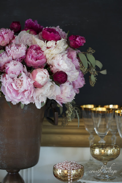 Peonies and gold glasses NYE
