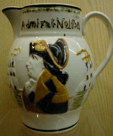 Hand-painted jug with Nelson's face on it, reading 'Admiral Nelson'