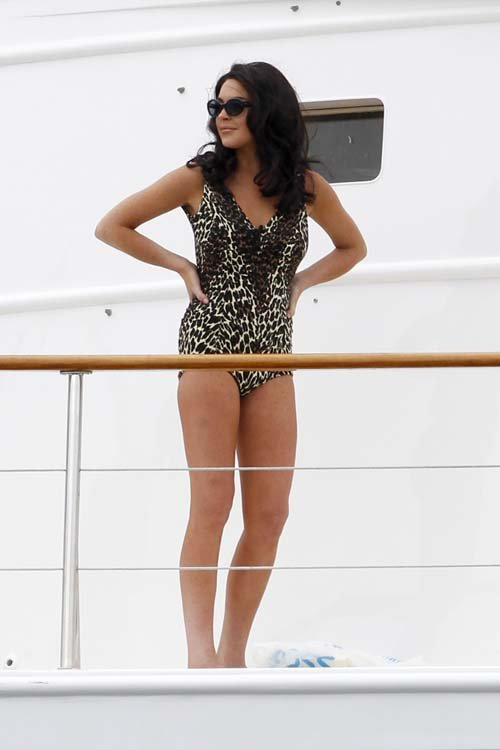 LINDSAY LOHAN in a leopard print swimsuit on the set of Liz and Dick