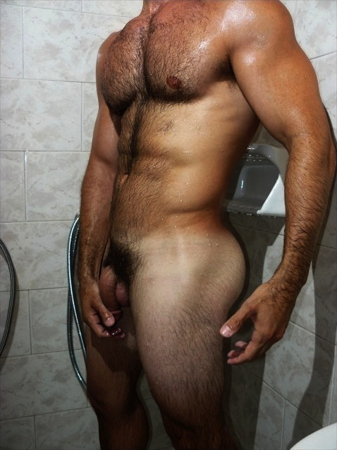 Naked guy getting in shower — 14
