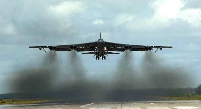 A B-52 Stratofortress takes off.