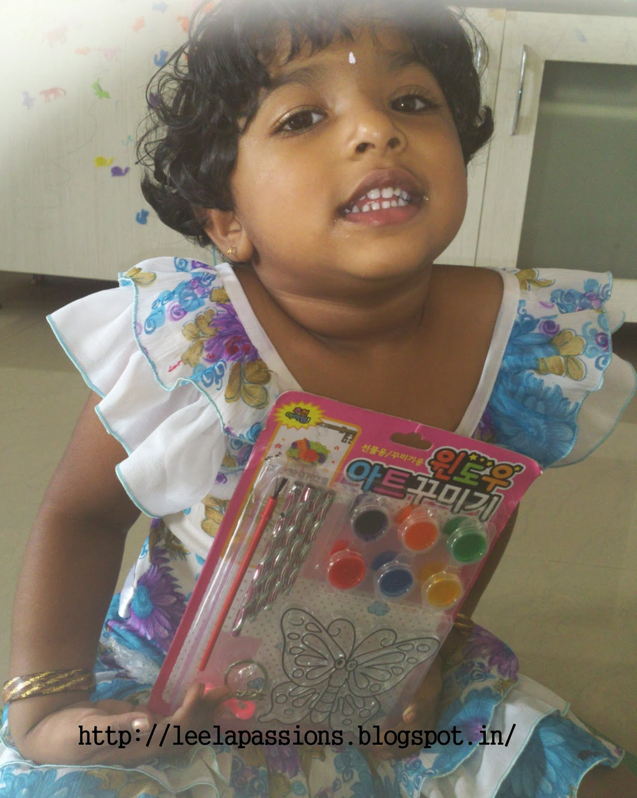 Little medha growing up 2013 i have bought do it yourself color windchime for medha when she was around 2 years 3 months old this pack contains butterfly shape paint colors solutioingenieria Image collections