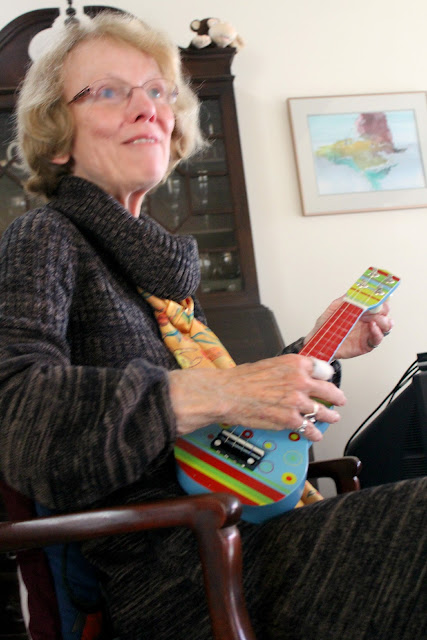 pam tuning a colorful toy guitar