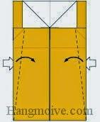 Bước 6: Mở lớp giấy, kéo và gấp chéo hai góc giấy vào trong.