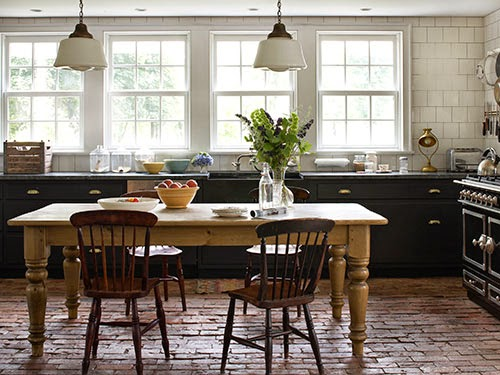Meet me in philadelphia the appeal of a brick floor for Country kitchen flooring