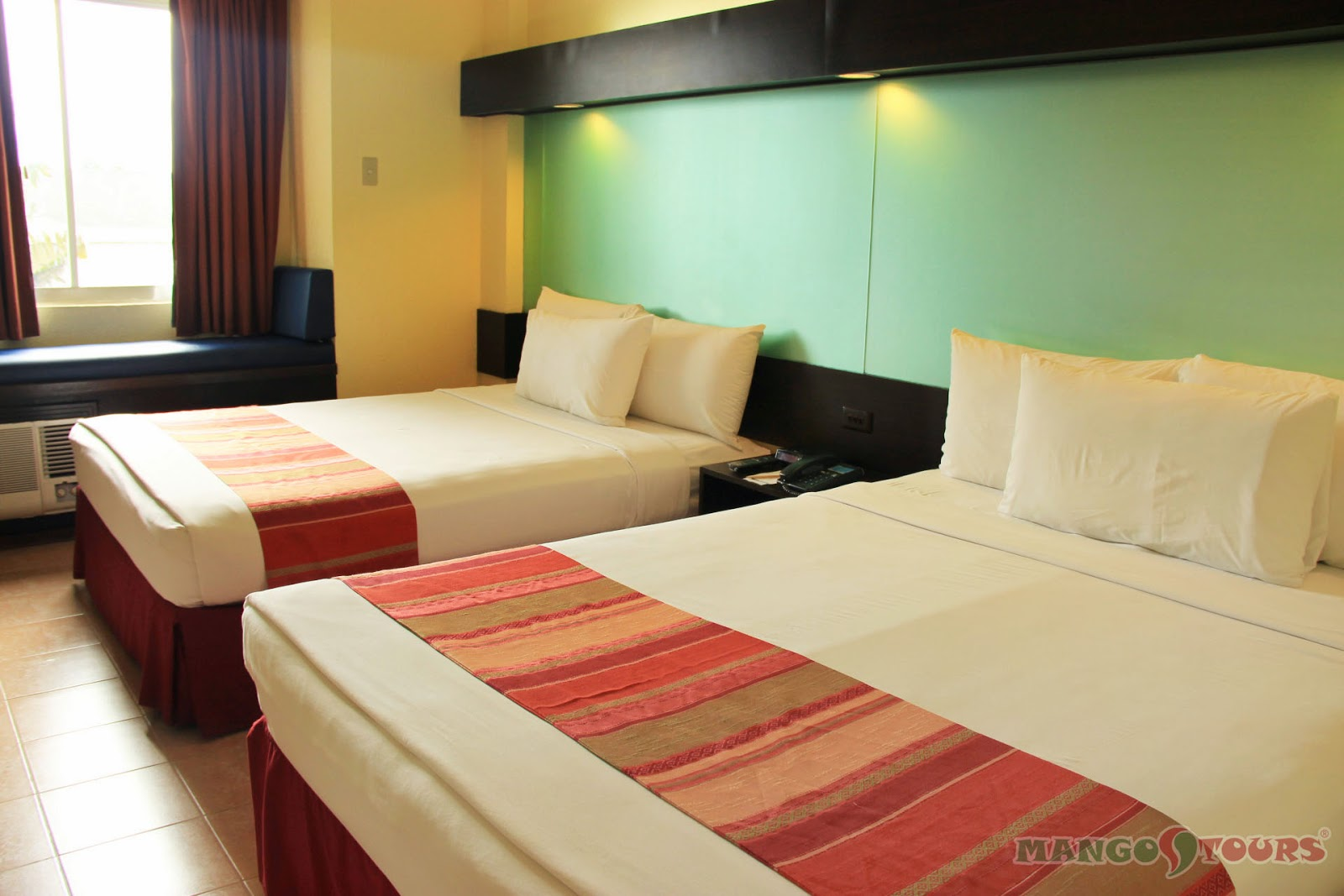 Mango Tours Microtel by Wyndham Sto. Tomas Batangas double-bed room