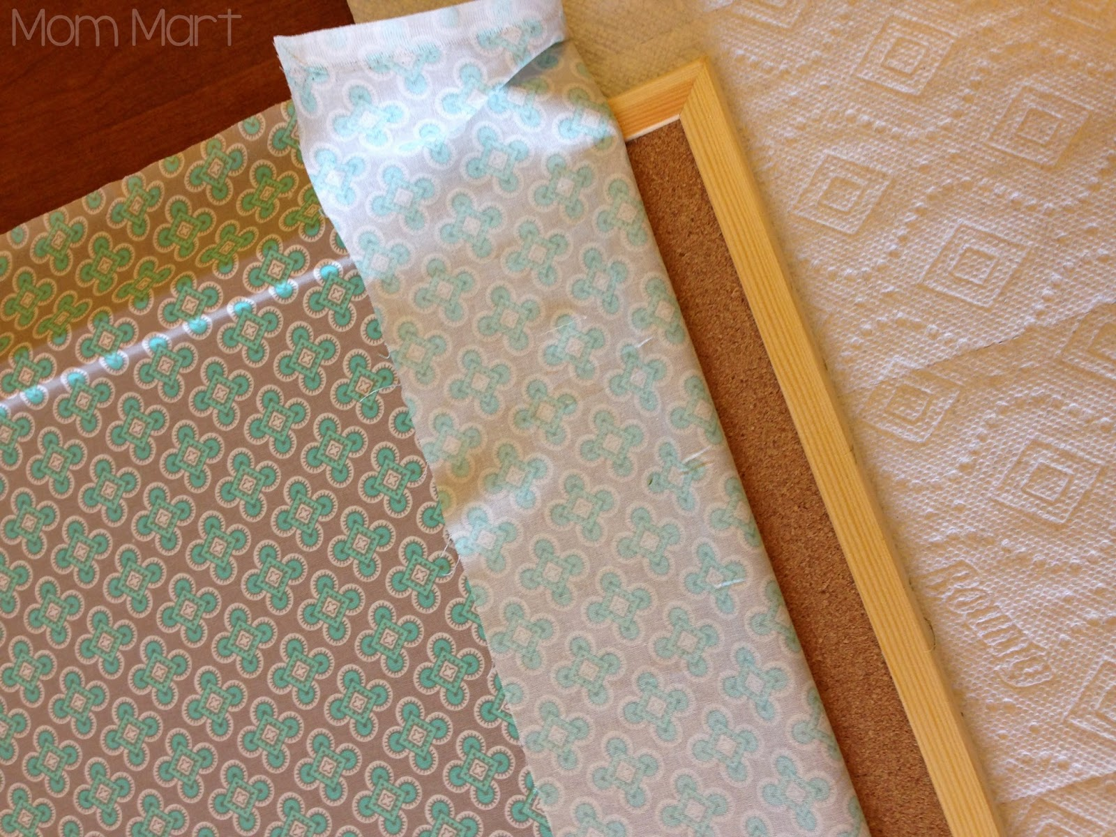 DIY fabric covered cork board with a faux nail head trim