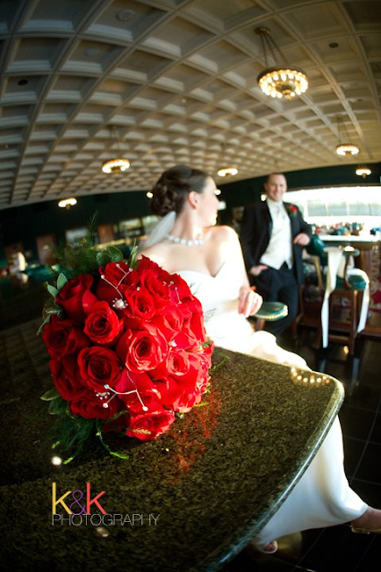 Valentine Wedding flowers by Stein Your Florist Co. Red roses and stargazer lilies.