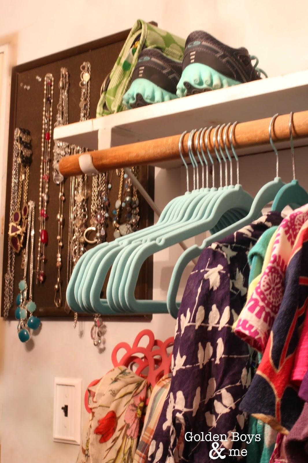 Velvet hangers in master closet-www.goldenboysandme.com