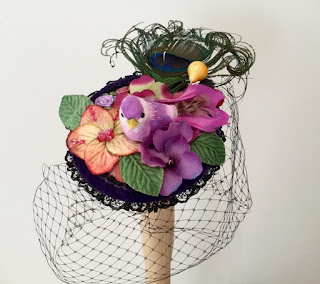 https://folksy.com/items/3332298-Purple-bird-fascinator-handmade-bird-cocktail-hat-