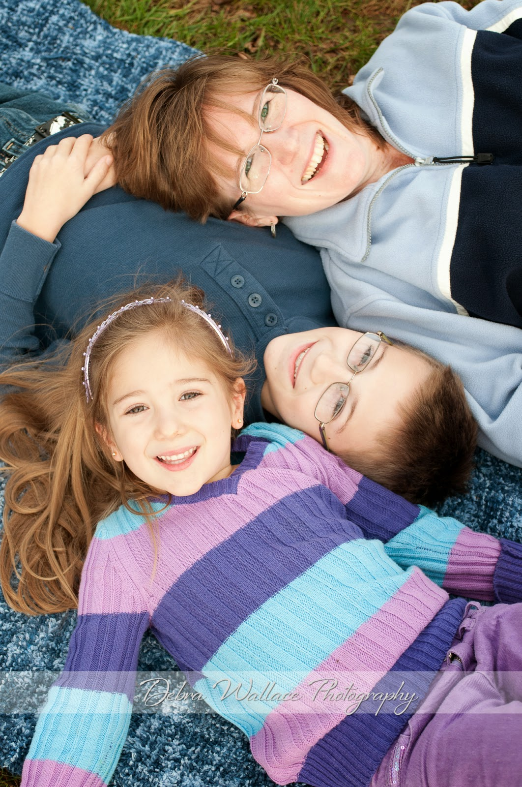 relaxing time with mom and children on a blanket in the fall