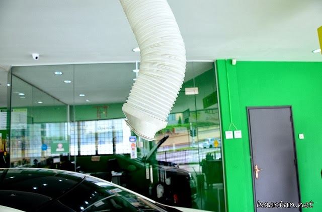 Air cond duct directed straight to your window cooling you down while you wait