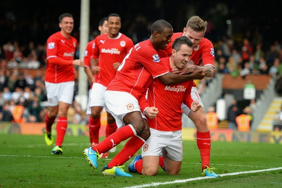 Jordan Mutch is mobbed by Cardiff teammates after scoring the winning goal against Fulham