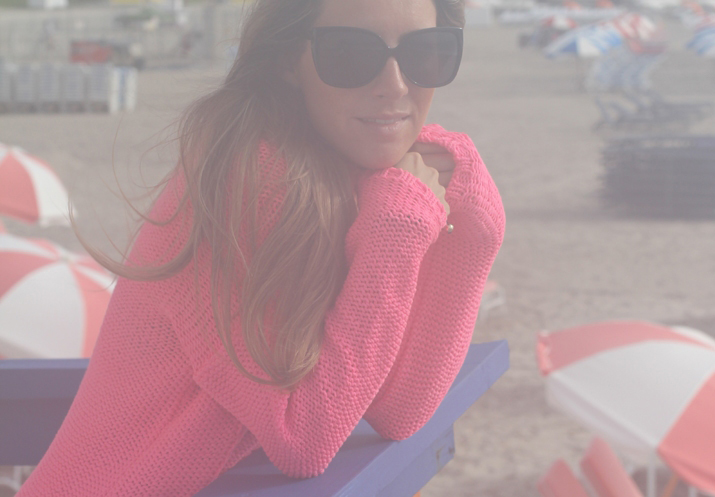 Fashion blogger with summer sweater at Miami Beach