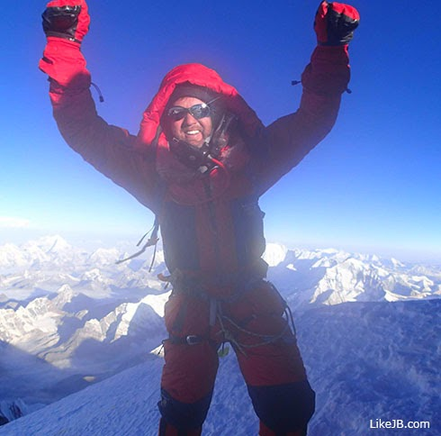 John Beede 'Chief World Explorer' on Mt. Everest's summit