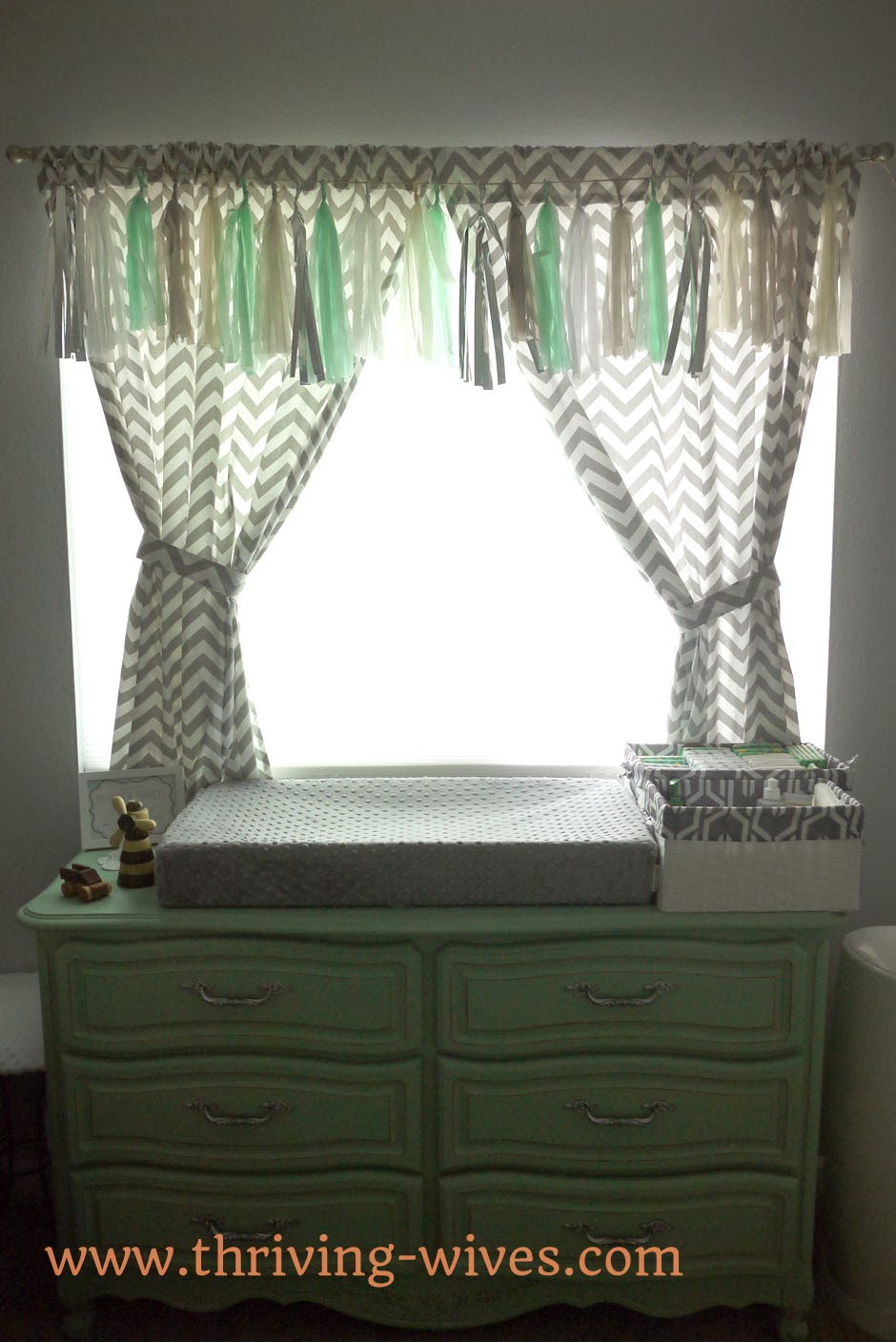 mint and grey gender neutral baby nursery