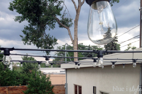String lights attached to guide wire. Here's what the completed string  light installation ... - Outdoor Style} How To Hang Commercial Grade String Lights Blue I