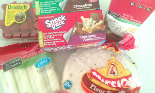 groceries: tortillas, cheese sticks, raspberries, pudding, egg whites