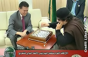 Libyan Lleader Moammar Gaddafi Playing Chess with  Kirsan Ilyumzhinov