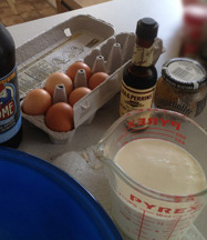 various ingredients for savory bread pudding. Oakshire Brewing, Ill-tempered Gnome, eggs, cream in measuring cup