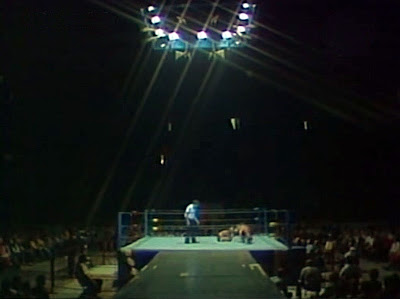 Wrestling ring at Maple Leaf Gardens is lit from above with a ramp for the wrestlers to walk to the ring.