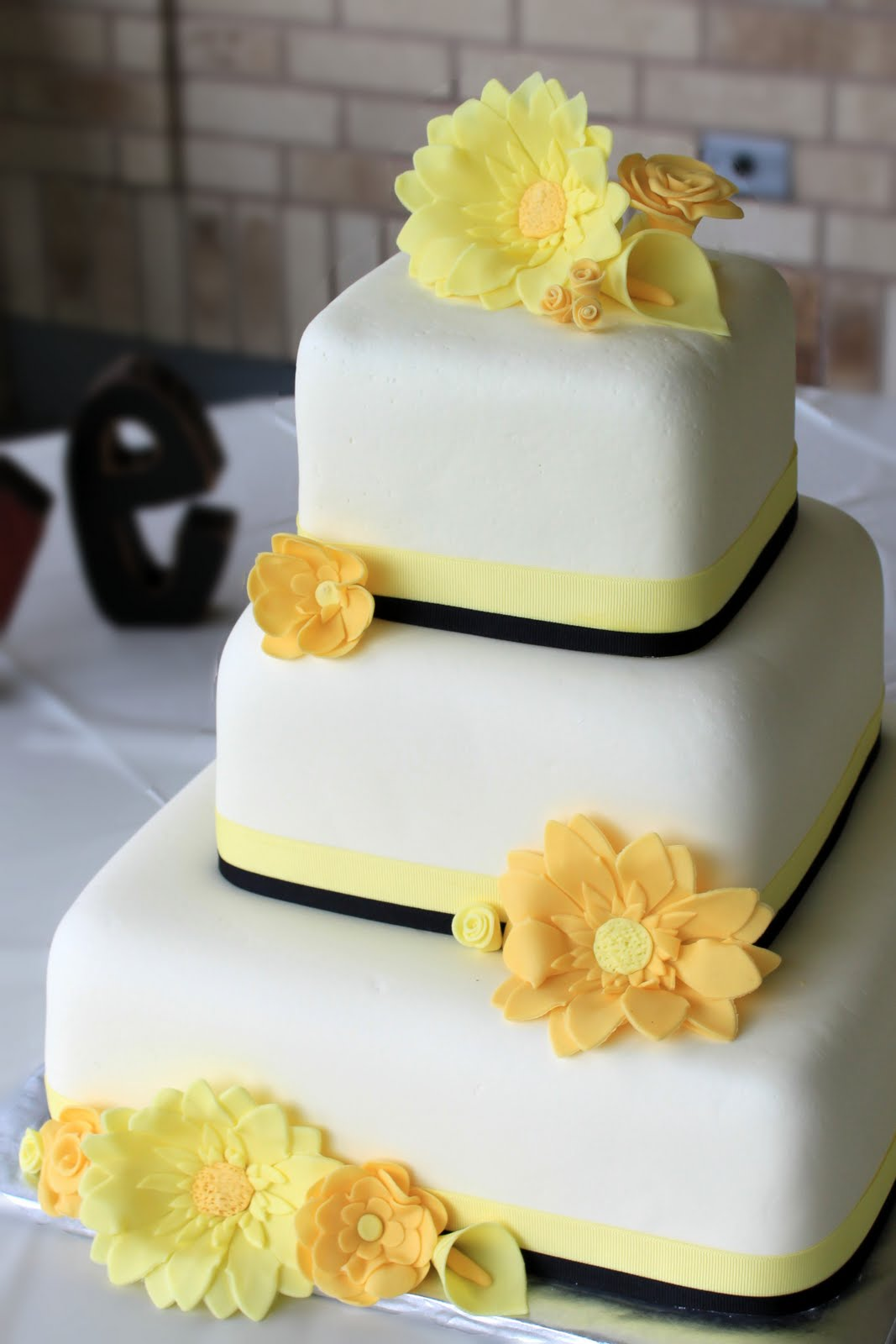 Tiered White Cake With Yellow Balls