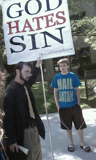 god hates sin. guy in hail satan shirt