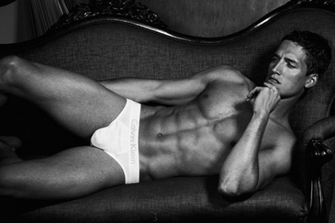 Tyler Kenyon lying on couch in underwear by Renie Saliba