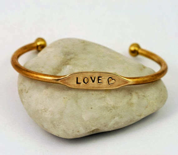 https://www.etsy.com/listing/174249875/love-gold-brass-cuff-bracelet?ref=shop_home_active_1&ga_search_query=love