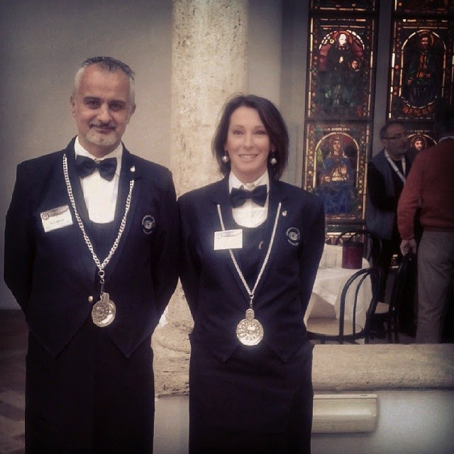 Two sommeliers wearing their tasting spoons and uniform in Montalcino