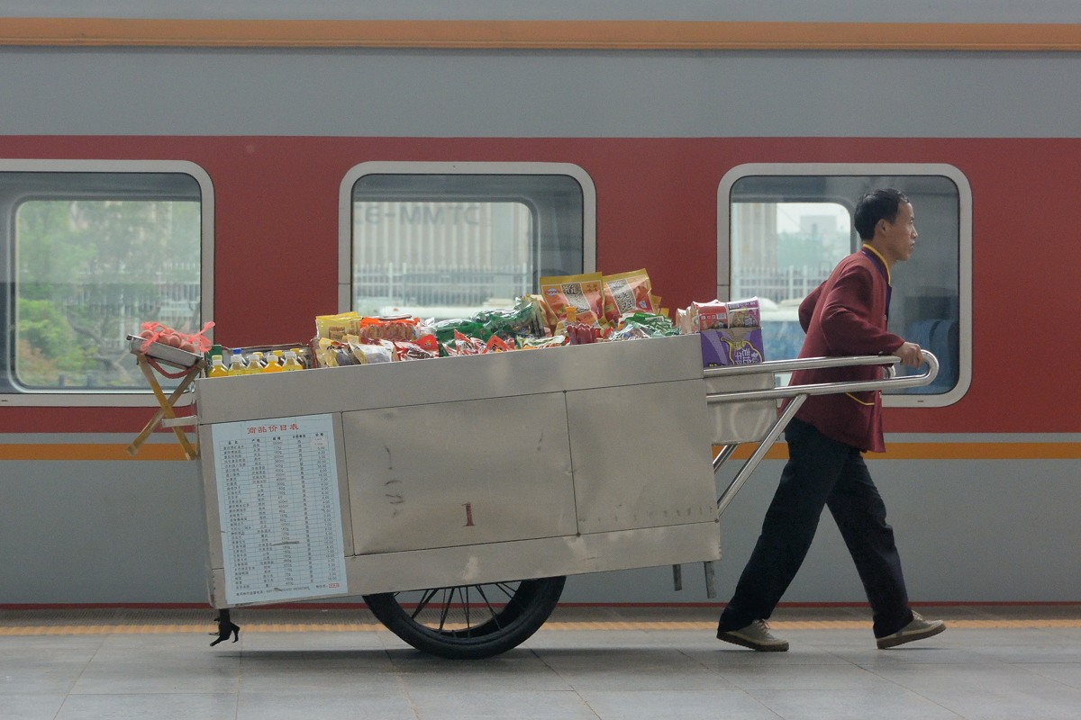 Vendor on rail station platform in China