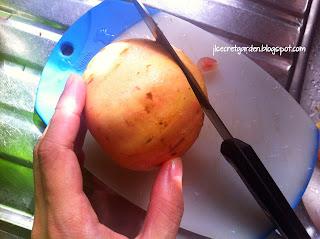 將石榴頂同底切平 cutting pomegranate
