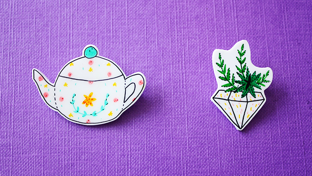 illustrated badges made from shrink plastic, teapot and succulent plant in planter