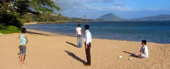 Misaki, Lisa, Hiroto and Tsutsumi on a sunny beach.