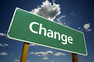 A street sign that says Change on it