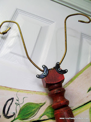 recycled lamp harp as table leg dragonfly antenna