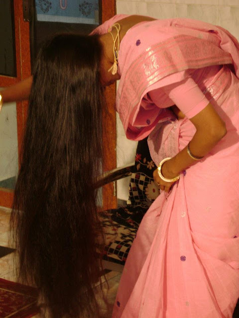 Kerala long hair girl brushing