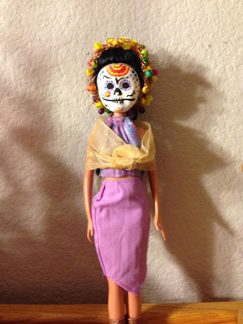 A doll dressed in a Mexican Day of the Dead costume.