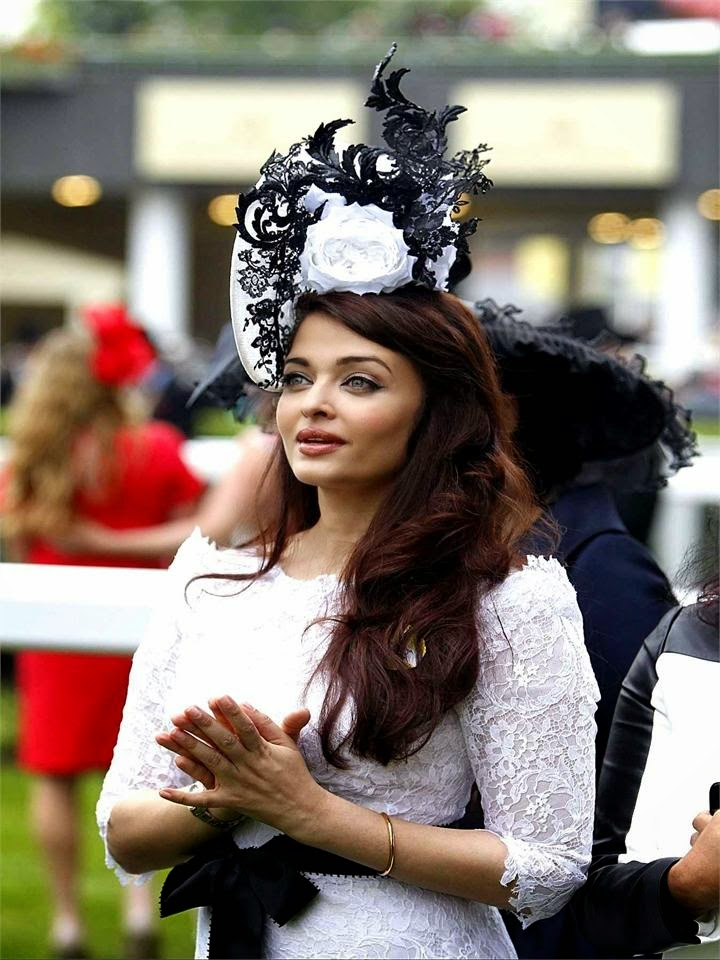 Aishwarya Rai loosk very fat and sexual in her white transparent skirt showing her huge cleavage hot pics of hot bollywood actress