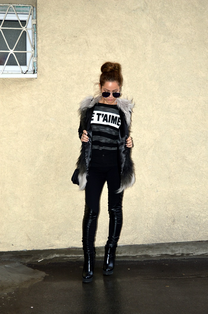 outfit, faux fur vest, black grey faux fur vest, black faux leather leggings, striped crop top sweater, blue mirrored aviator sunglasses