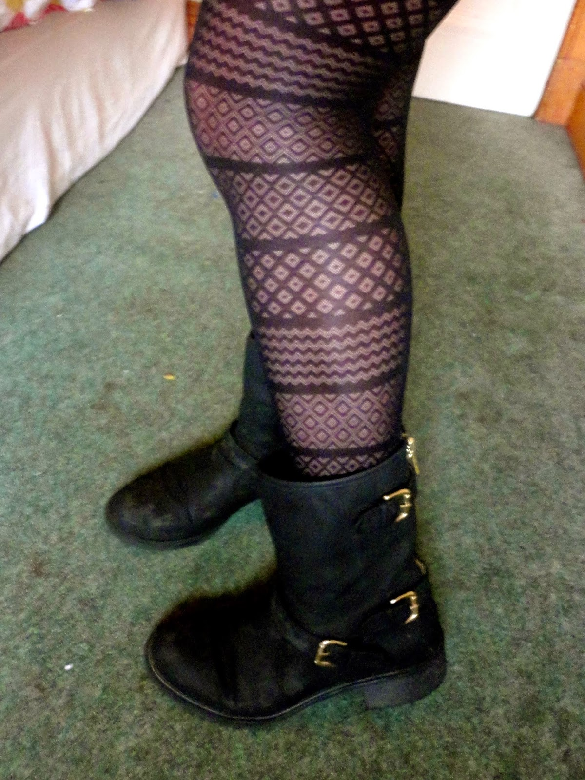 Outfit details of patterned tights and black biker boots