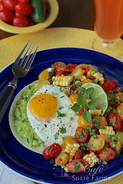 Huevos Rancheros - a healthy and super-delicious take on this classic Southwestern dish, featuring sweet, tender corn, tomatoes and California Avocados.