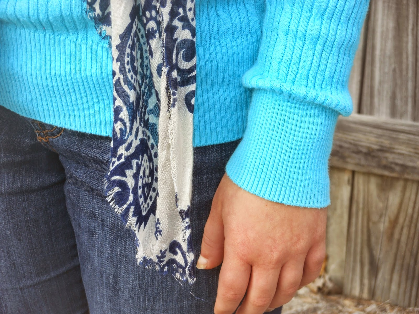 Turquoise and Peach. Turquoise sweater, jeans, navy and ivory scarf, peach boot socks, riding boots.