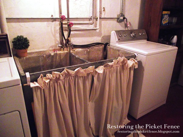 Sew a $6 skirt for a cast iron sink. Use a dowel and over-the-door hooks to hang it.