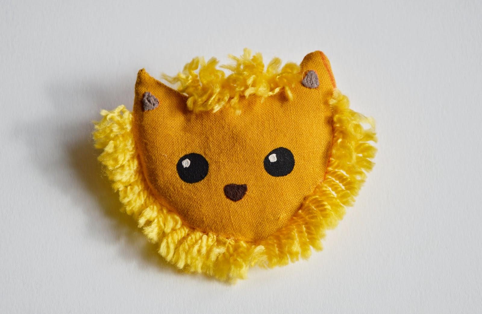 https://www.etsy.com/fr/listing/228371531/broche-a-tete-de-lion-jaune-sauvage-en?ref=pr_shop