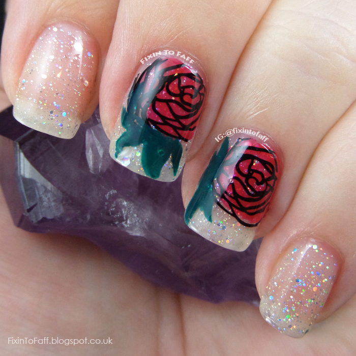 Romantic and sparkly nail art featuring roses and diamond glitter.