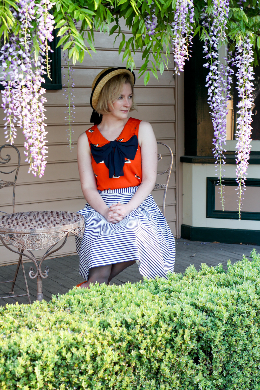 @findingfemme wears Review Australia skirt, Mimco flats and orange duck blouse with straw boater.