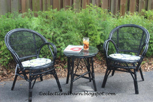 Black wicker chairs and side table