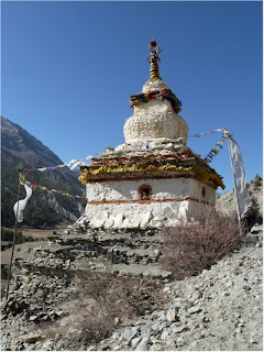 Trekking past a holy shrine to Annapurna