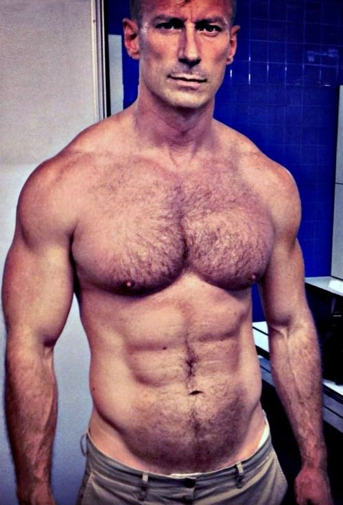 Muscular Beefy Hunk Enjoying Lip Service
